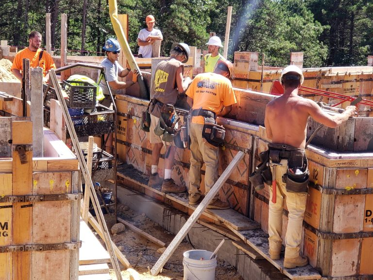 Pouring concrete for the foundation of FORWARD at the Rock