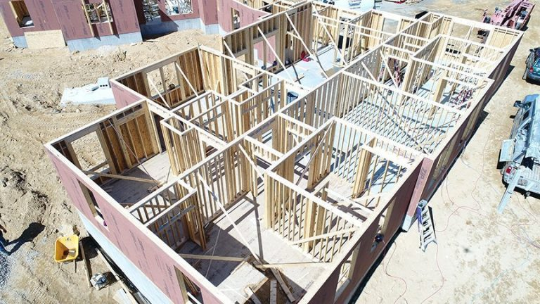 An aerial view of the framing one of the buildings at FORWARD at the Rock